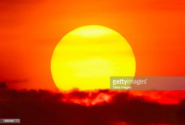 usa, new york city, large sun at sunset - inferno stock photos and pictures
