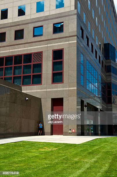 new york city life, woman at office building, lower manhattan - world financial center new york city stock pictures, royalty-free photos & images