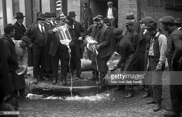New York City Liquor Agent Izzy Einstein dumping liquor into gutter during prohibition