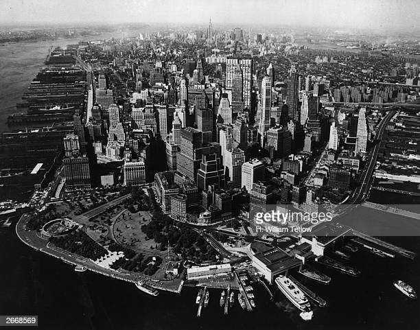 New York City looking north The Hudson River is to the left and Battery Park in the foreground Passenger ferries are in the right foreground with the...