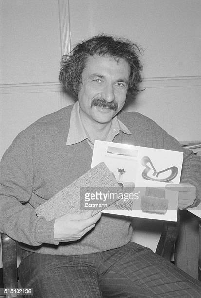Los Angeles architect Frank O Gehry holds a sample of the corrugated paperboard material from which furniture in picture is made Gehry a professor of...
