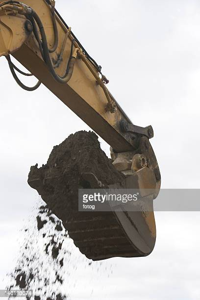USA, New York City, low angle view of digger scoop full of soil