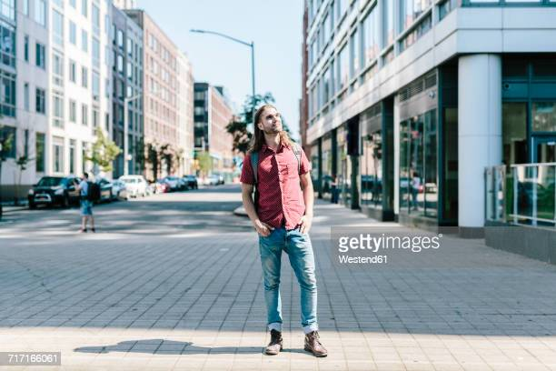 USA, New York City, man looking around in Williamsburg, Brooklyn