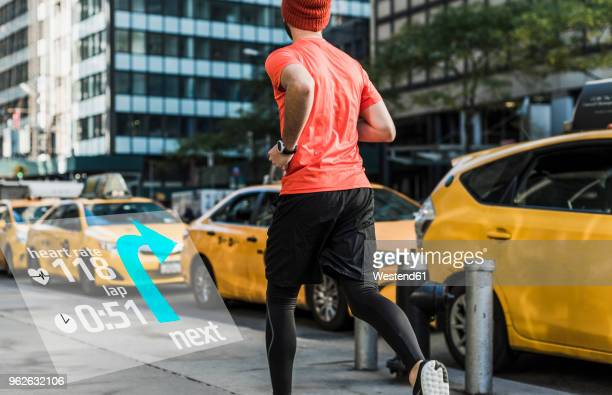 usa, new york city, man running in the city with data around him - digital composite stock-fotos und bilder