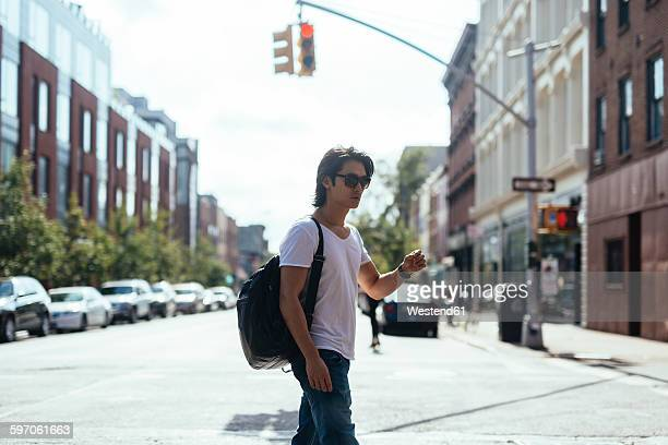 usa, new york city, man walking in the middle of the road in williamsburg - williamsburg new york city stock pictures, royalty-free photos & images