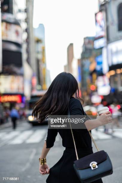 usa, new york city, manhattan, back view of woman with coffee to go on the street - long purse stock photos and pictures