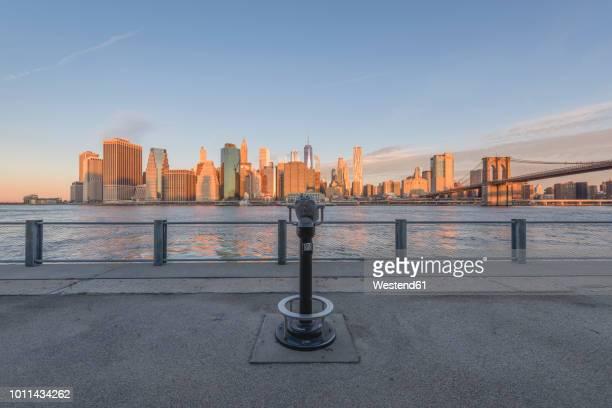 USA, New York City, Manhattan, Brooklyn, cityscape with coin operated binoculars