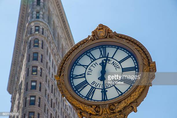 CONTENT] New York City Manhattan Flatiron building construction architecture skyscraper broadway fifht avenue clock watch sunny day clear sky...