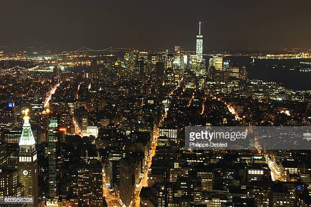 usa, ny, new york city, manhattan, lower manhattan skyline at night - broadway manhattan stock photos and pictures
