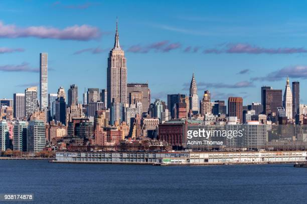 new york city, manhattan midtown skyline, usa - new york skyline stock photos and pictures