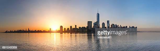 USA, New York City, Manhattan, panorama of financial district at sunrise