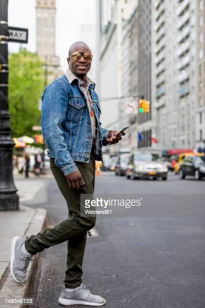 USA, New York City, Manhattan, portrait of stylish man in the city
