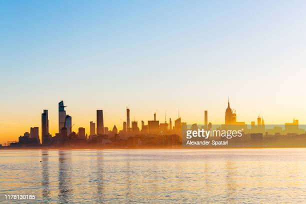 new york city manhattan skyline at sunrise with hudson river, united states - hudson yards stock pictures, royalty-free photos & images