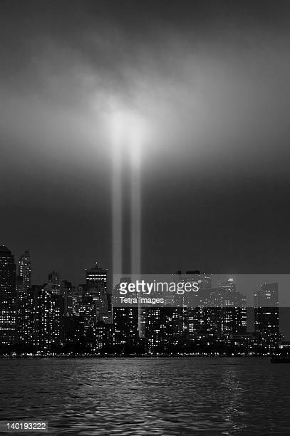 usa, new york city, manhattan skyline with 9/11 memorial lights - world trade center manhattan stock pictures, royalty-free photos & images