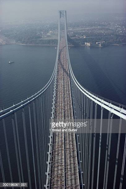 USA, New York City Marathon runners on Verrazano bridge, aerial view