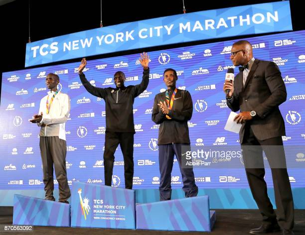 New York City Marathon winner Geoffrey Kamworor of Kenya waves to the crowd during the awards ceremony alongside second place winner Wilson Kipsang...