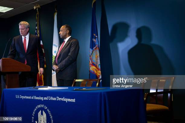 New York City Mayor Bill de Blasio and Ben Carson, Secretary of Housing and Urban Development , take questions after signing a ceremonial agreement...