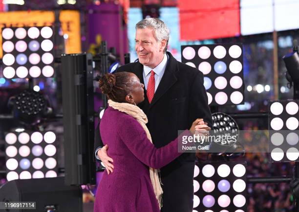 New York City Mayor Bill de Blasio and First Lady Chirlane McCray attend the Times Square New Year's Eve 2020 Celebration on December 31 2019 in New...