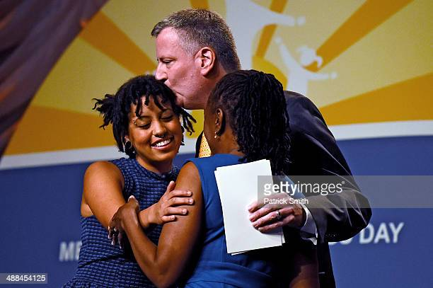 New York City Mayor Bill de Blasio and his wife, Chirlane McCray hug their daughter, Chiara de Blasio , before she received a special recognition...