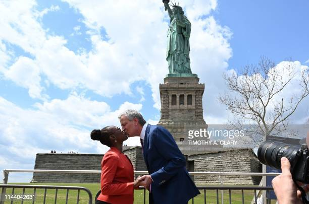 New York City Mayor Bill de Blasio and his wife Chirlane McCray kiss as they arrive at Liberty Island for the Statue of Liberty Museum Dedication...