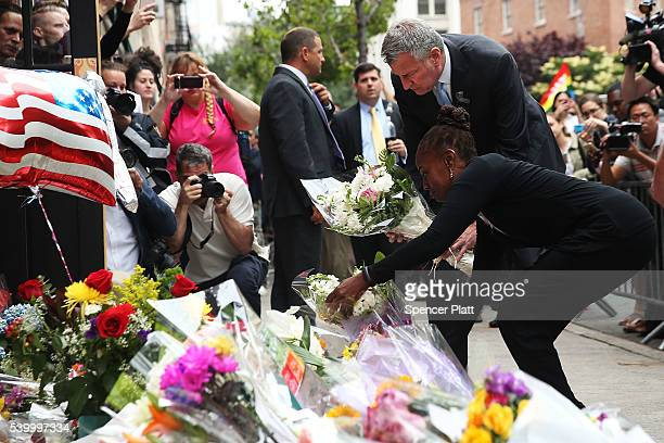 New York City Mayor Bill de Blasio and his wife Chirlane McCray pause in front of the iconic New York City gay and lesbian bar The Stonewall Inn to...