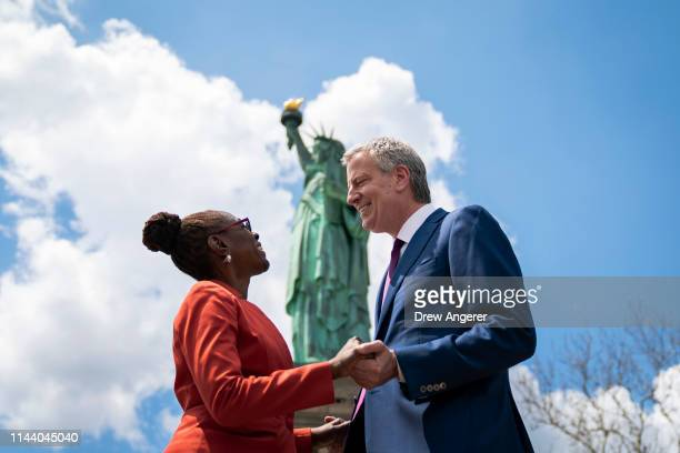 New York City Mayor Bill de Blasio and his wife Chirlane McCray stop in front of the Statue of Liberty following a dedication ceremony for the new...