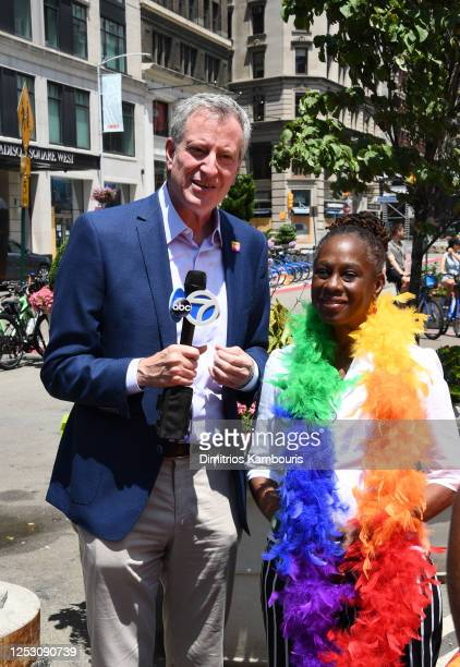 New York City Mayor Bill de Blasio and his wife Chirlane McCray take part in the 50th anniversary of the first Pride march on June 28, 2020 in New...