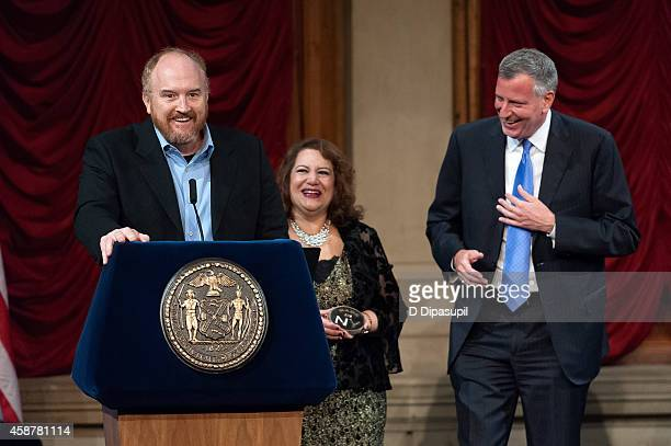 New York City mayor Bill de Blasio and New York City Mayor's Office of Media and Entertainment commissioner Cynthia Lopez look on as honoree Louis CK...