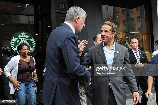 New York City Mayor Bill de Blasio and New York Gov Andrew Cuomo shake hands after touring the site of the bomb blast on 23rd St in Manhattan's...