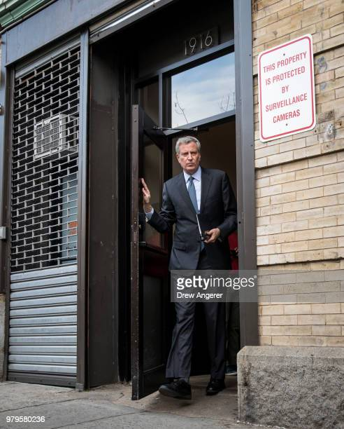 New York City Mayor Bill de Blasio speaks to the press following a visit to the Cayuga Center in East Harlem a facility currently accepting children...
