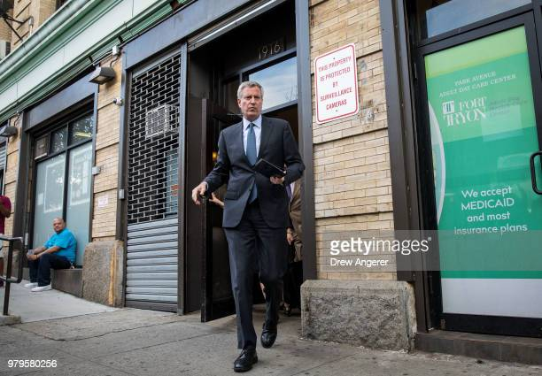 New York City Mayor Bill de Blasio arrives for a press conference following a visit to the Cayuga Center in East Harlem a facility currently...