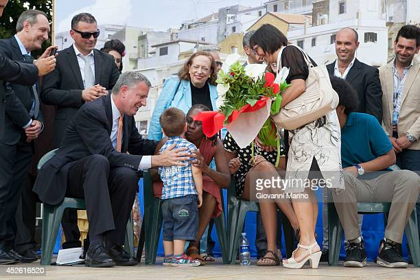 New York City Mayor Bill de Blasio Chirlane McCray and family receive gifts at a welcome ceremony during a visit to Mayor de Blasio's grandmother's...
