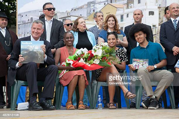 New York City Mayor Bill de Blasio, Chirlane McCray, Chiara de Blasio and Dante de Blasio receive gifts during a visit to Mayor de Blasio's...