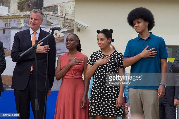 New York City Mayor Bill de Blasio, Chirlane McCray, Chiara de Blasio and Dante de Blasio stand for the national anthem at a welcome ceremony during...