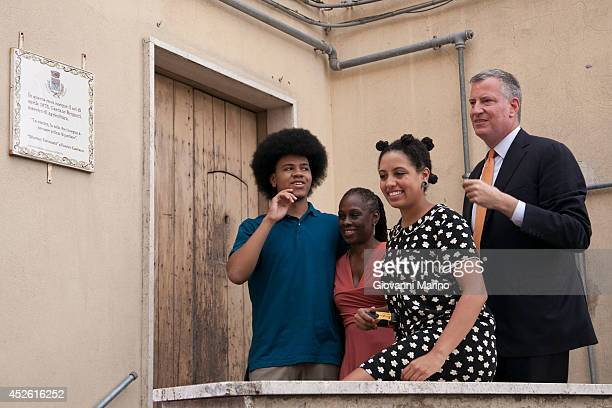 New York City Mayor Bill de Blasio , Chirlane McCray , Chiara de Blasio and Dante de Blasio visit the house his grandmother was born in during a...