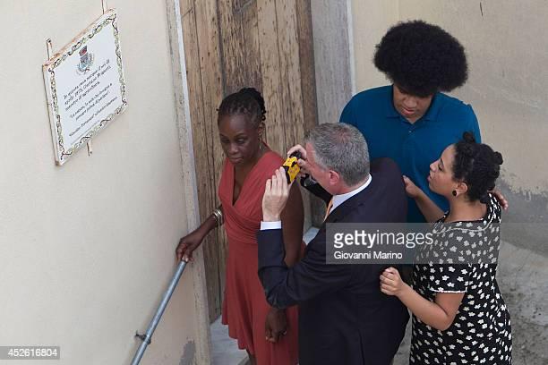 New York City Mayor Bill de Blasio Chirlane McCray Chiara de Blasio and Dante de Blasio visit the house his grandmother was born in during a visit to...
