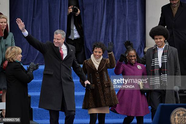 New York City Mayor Bill de Blasio daughter Chiara wife Chirlane and son Dante wave from the steps of City Hall in Lower Manhattan on January 1 2014...
