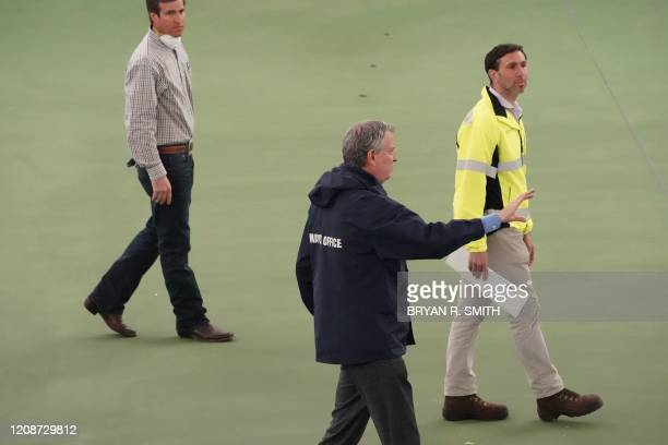 New York City Mayor Bill de Blasio does a walk through of the tennis courts that will one transformed into a a 350bed temporary hospital at the USTA...