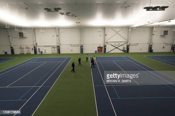 New York City Mayor Bill de Blasio does a walk through of the tennis courts that will one transformed into a a 350-bed temporary hospital at the USTA...