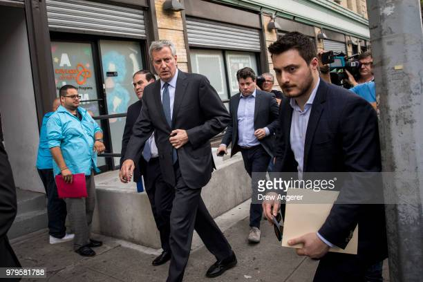 New York City Mayor Bill de Blasio exits a press conference following a visit to the Cayuga Center in East Harlem a facility currently accepting...