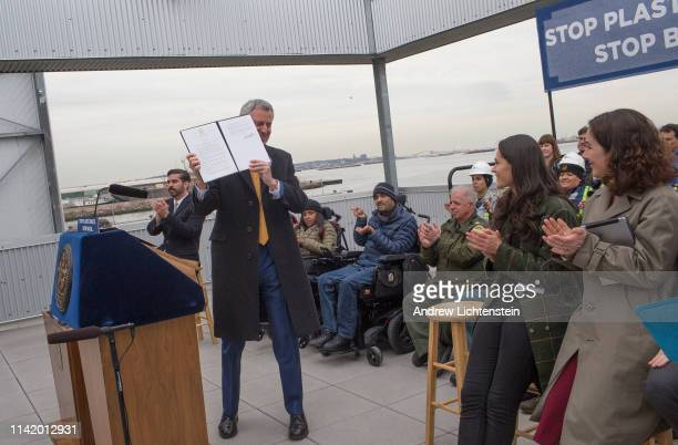 New York City Mayor Bill De Blasio holds a press conference at a city recycling center processing plant to sign a bill banning singleuse plastics in...