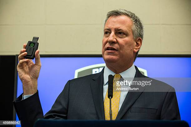 New York City Mayor Bill de Blasio holds up a body camera that the New York Police Department will begin using during a press conference on December...
