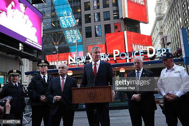 New York City Mayor Bill de Blasio is joined by Police Commissioner William Bratton at a news conference in Times Square where the two spoke about a...