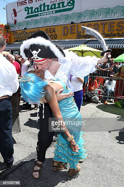 New York City Mayor Bill de Blasio kisses his wife Chirlane McCray in front of Nathan's at the 2014 Mermaid Parade at Coney Island on June 21 2014 in...