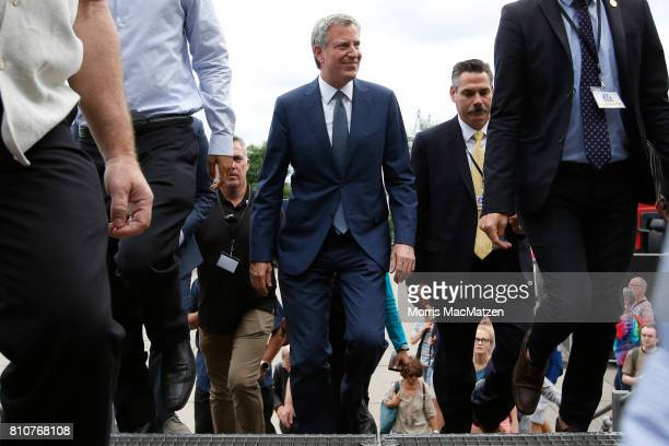 New York City Mayor Bill de Blasio leaves after attending a convention beside a demonstration against the G20 economic summit during a protest march...