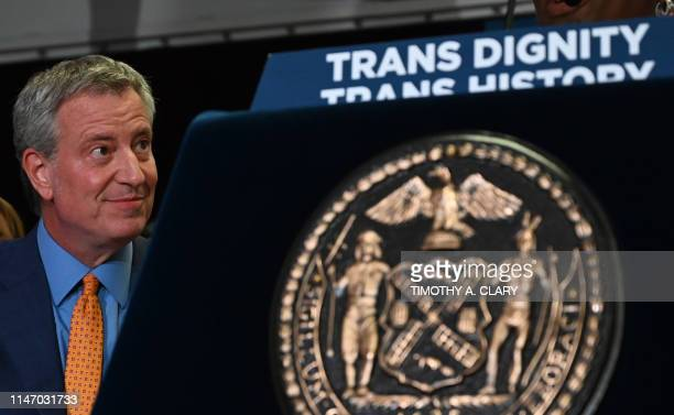 New York City Mayor Bill de Blasio listens to his wife speak during an event at the The Lesbian Gay Bisexual Transgender Community Center in New York...