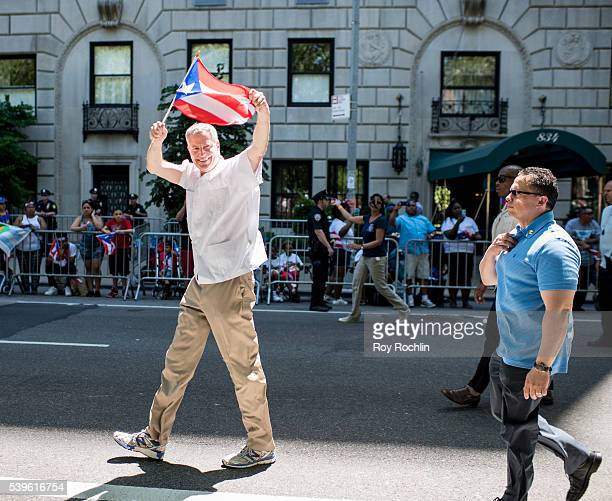 New York City Mayor Bill de Blasio marches during the Puerto Rican Day Parade on June 12 2016 in New York City