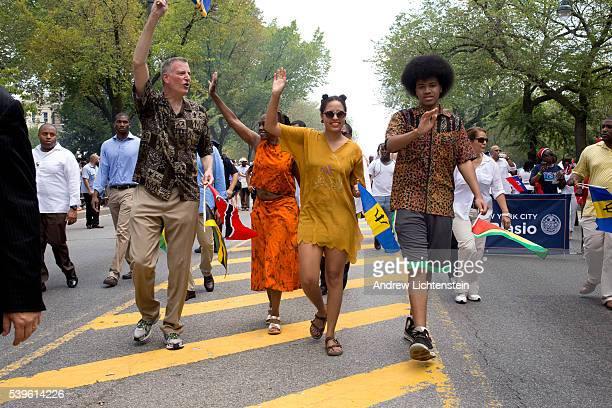 New York City Mayor Bill De Blasio marches in Brooklyn's West Indian Day Parade with his popular family Chirlane McCray his wife Dante his son and...