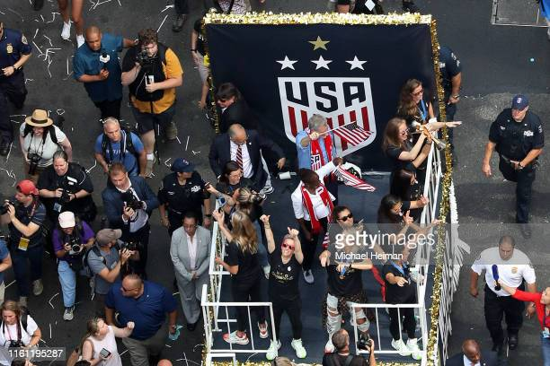 New York City Mayor Bill de Blasio rides on a float with Megan Rapinoe Julie Ertz and the rest of the USA Women's National Soccer Team as they...
