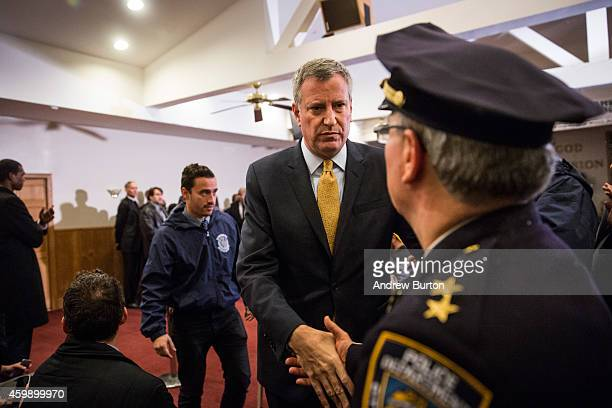 New York City Mayor Bill de Blasio shakes hands with New York Police Department Borough Commander for Staten Island Edward Delatorre after speaking...